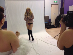 Bambi la Belle laughing at pinup shoot